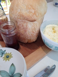 Homemade bread, jam and cream